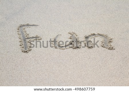 the word fun written on sand in a tropical relaxing beach