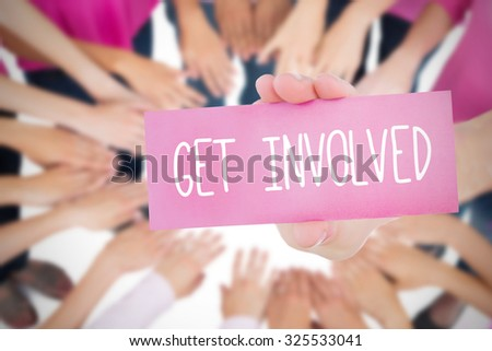 The word get involved and young woman holding blank card against oktoberfest graphics - stock photo