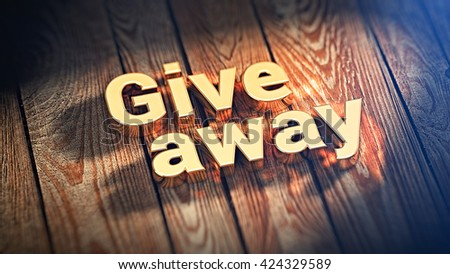 """The word """"Giveaway"""" is lined with gold letters on wooden planks. 3D illustration image - stock photo"""
