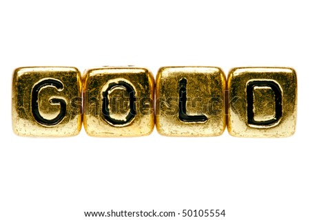The word gold spelled out in gold blocks - stock photo