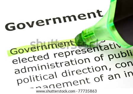The word Government highlighted in green with felt tip pen. - stock photo