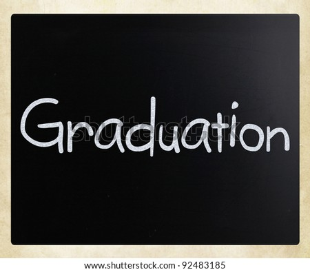 "The word ""Graduation"" handwritten with white chalk on a blackboard"