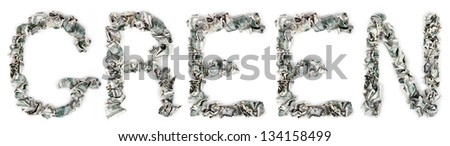 The word 'green', made out of crimped 100$ bills. Isolated on white background. - stock photo