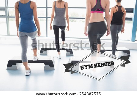 The word gym heroes and aerobics class in session against badge - stock photo