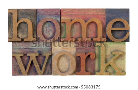 the word homework in vintage wooden letterpress type blocks, stained by color ink, isolated on white