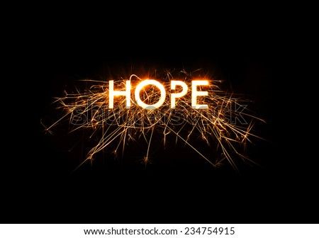 The word Hope set in sparklers design on black background. - stock photo