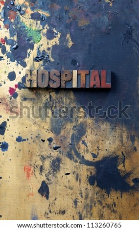 The word hospital written in antique letterpress printing blocks. - stock photo
