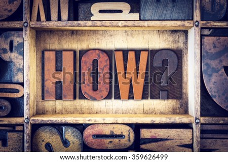 "The word ""How"" written in vintage wooden letterpress type. - stock photo"