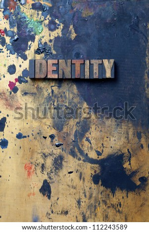 The word Identity written in antique letterpress printing blocks. - stock photo