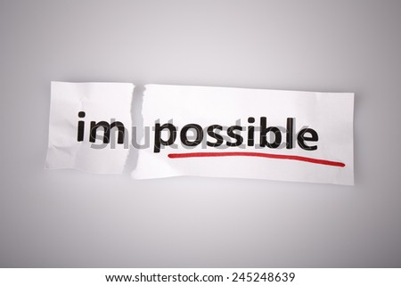 The word impossible changed to possible on torn paper and white background - stock photo