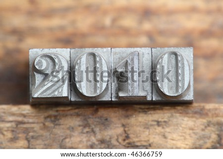 the word 2010 in letterpress type on a wooden background. - stock photo