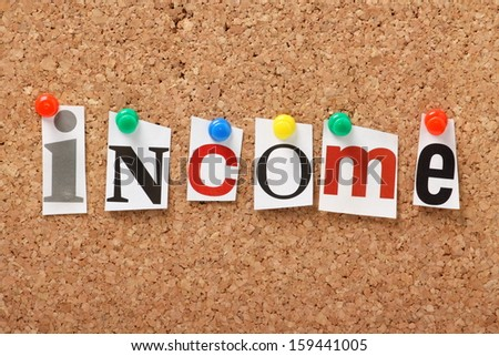 The word Income in cut out magazine letters pinned to a cork notice board