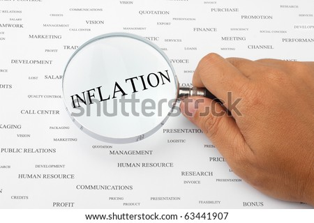 The word INFLATION is magnified.
