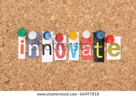 The word Innovate in cut out magazine letters pinned to a cork notice board