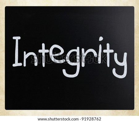 """The word """"Integrity"""" handwritten with white chalk on a blackboard - stock photo"""