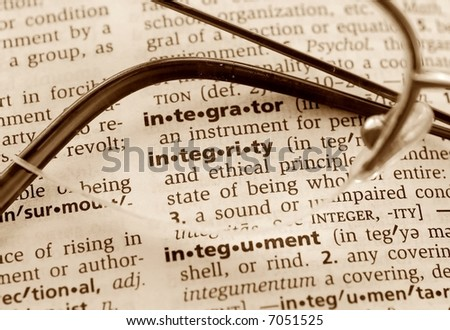 The word integrity through a pair of glasses - stock photo