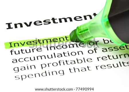 The word Investment highlighted in green with felt tip pen