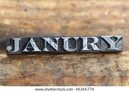 the word january in letterpress type on a wooden background. - stock photo