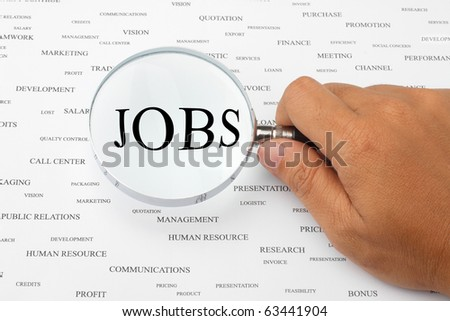 The word JOBS is magnified. - stock photo