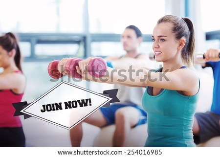 The word join now! and people lifting dumbbell weights in the gym against badge - stock photo