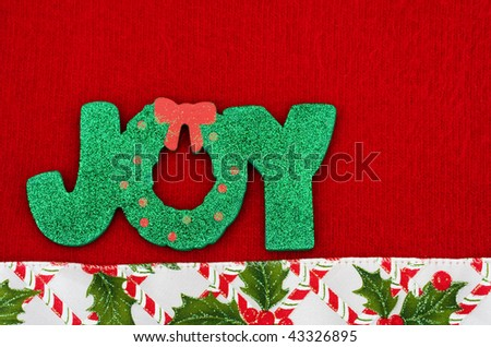The word joy on a red background with a holly berry border, joy - stock photo