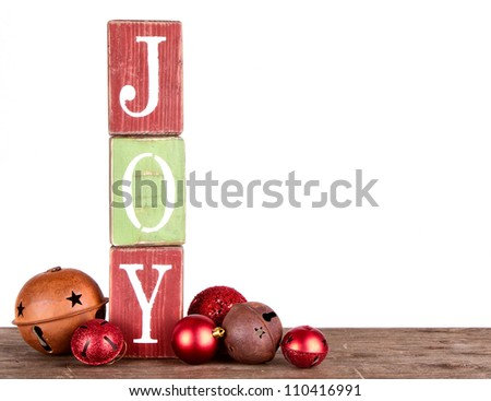 The word joy spelled out on blocks, isolated on white, Christmas ornaments. - stock photo