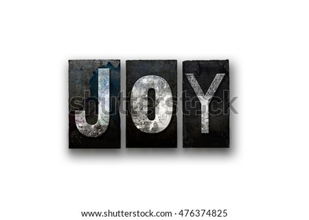 "The word ""JOY"" written in vintage, dirty, ink stained letterpress type and isolated on a white background."