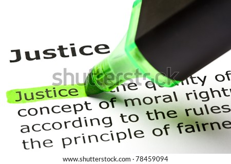 The word Justice highlighted in green with felt tip pen. - stock photo