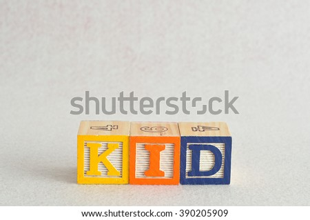 The word kid spelled with colorful alphabet blocks isolated against a white background - stock photo