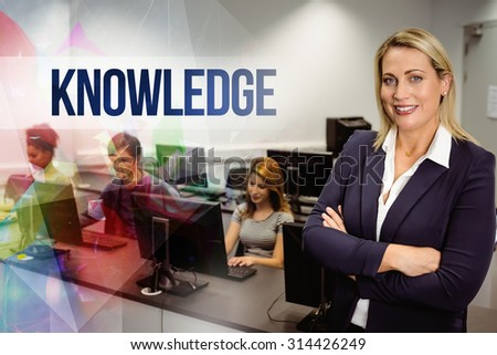 The word knowledge against computer teacher smiling at camera with arms crossed - stock photo
