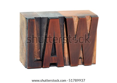 The word Law in old wooden letterpress type - isolated on white background - stock photo