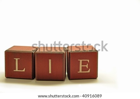 the word lie spelled out in rustic blocks - stock photo