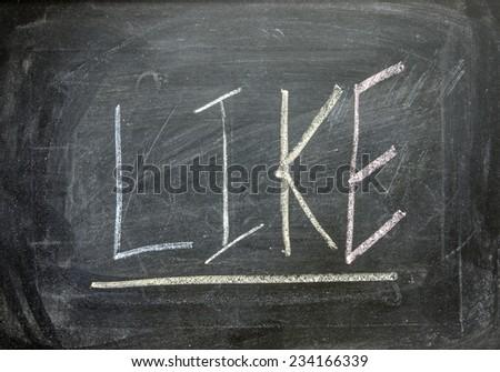 """The word """"LIKE"""" written on blackboard  - stock photo"""