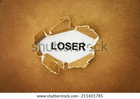 "the word ""loser"" in the hole of brown paper - stock photo"