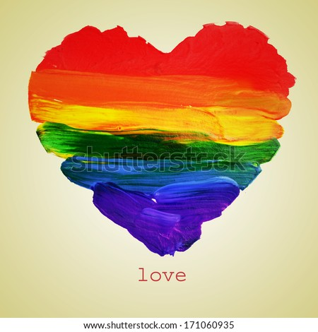 the word love and a rainbow heart painted on a beige background, with a retro effect - stock photo