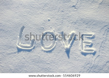 The word love drawn in the snow.