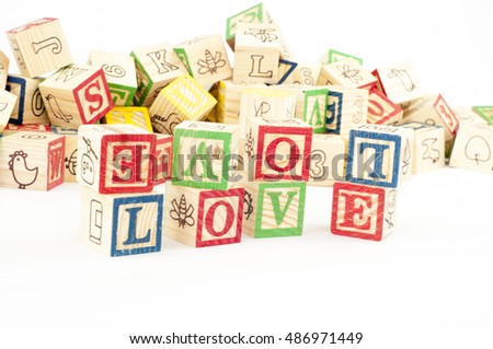 the word LOVE formed from cubical wood letter box.