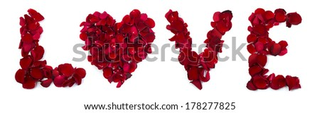 The word love is written with rose petals on a white background. A heart substitutes the letter o. - stock photo