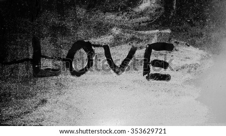 """The word """"Love"""" on the window in the rain,black and white,horizontal photo - stock photo"""