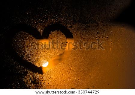 "The word ""Love"" on the window in the rain, horizontal photo - stock photo"