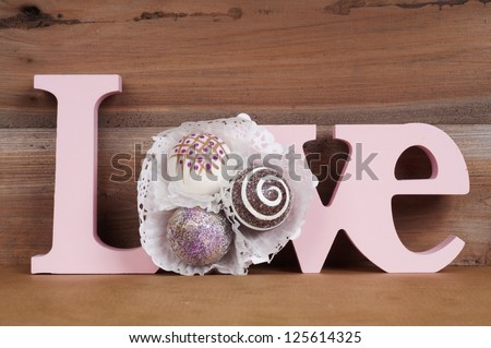 The word Love with bonbons ornament. Valentine card design - stock photo