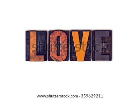 "The word ""Love"" written in isolated vintage wooden letterpress type on a white background."