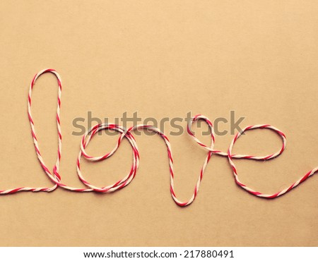 "The word ""love"" written with rope, retro instagram filter effect - stock photo"