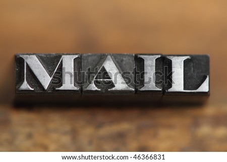 the word mail in letterpress type on a wooden background. - stock photo