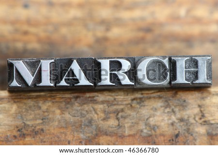 the word march in letterpress type on a wooden background.