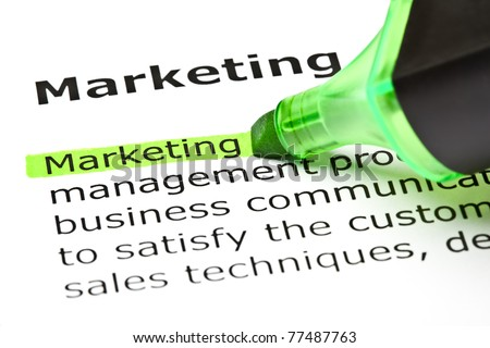 The word Marketing highlighted in green with felt tip pen. - stock photo