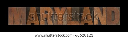 the word Maryland in old wood type - stock photo
