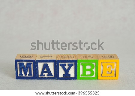 The word maybe spelled with colorful alphabet blocks isolated against a white background - stock photo