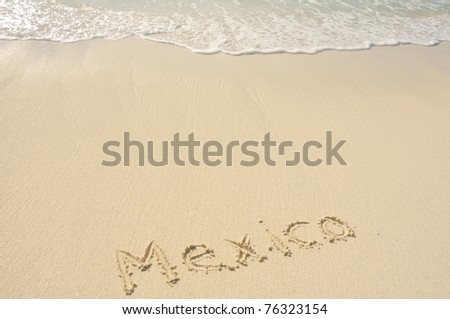 The Word Mexico Written in the Sand on a Beach - stock photo