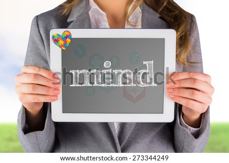 The word mind and businesswoman showing a tablet pc against medical icons in hexagons interface menu - stock photo